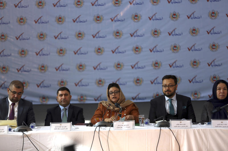 Hawa Alam Nuristani, chief of Election Commission of Afghanistan, center, speaks during a press conference at the Independent Election Commission office in Kabul, Afghanistan, Sunday, Dec. 22, 2019. The election commission is to announce the results of the Sept. 28 election Sunday. (AP Photo/Rahmat Gul)