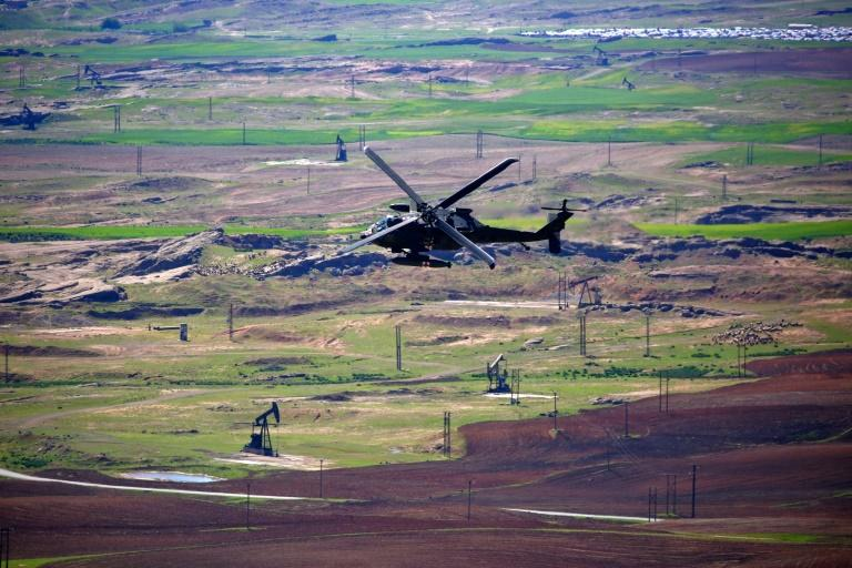 A medical helicopter, from the US-led coalition, flies over the site of Turkish airstrikes near northeastern Syrian Kurdish town of Derik on April 25, 2017