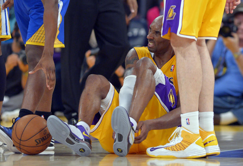 Los Angeles Lakers guard Kobe Bryant grimaces after being injured during the second half of their NBA basketball game against the Golden State Warriors, Friday, April 12, 2013, in Los Angeles. The Lakers won 118-116. (AP Photo/Mark J. Terrill)