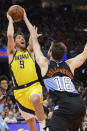 Indiana Pacers' T.J. McConnell (9) shoots over Cleveland Cavaliers' Cedi Osman (16) in the second half of an NBA basketball game, Saturday, Feb. 29, 2020, in Cleveland. Indiana won 113-104. (AP Photo/Tony Dejak)