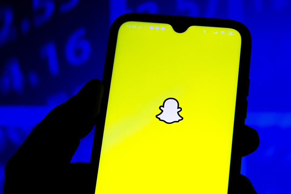 In this photo illustration the Snapchat logo seen displayed on a smartphone.