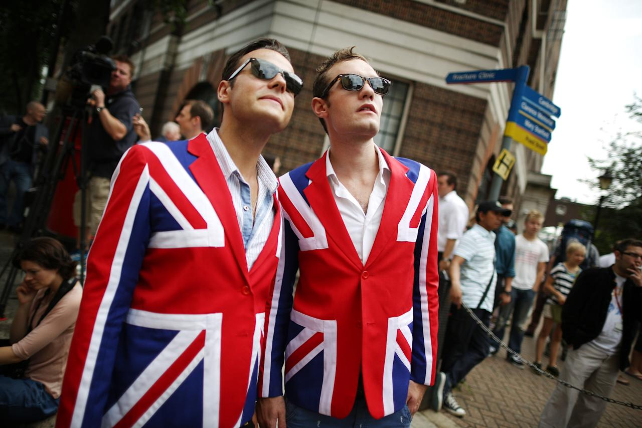 LONDON, ENGLAND - JULY 23: Men wearing matching Union flags blazers wait for Catherine, Duchess Of Cambridge and her newborn son at St Mary's Hospital on July 23, 2013 in London, England. The Duchess of Cambridge yesterday gave birth to a boy at 16.24 BST and weighing 8lb 6oz, with Prince William at her side. The baby, as yet unnamed, is third in line to the throne and becomes the Prince of Cambridge. (Photo by Peter Macdiarmid/Getty Images)
