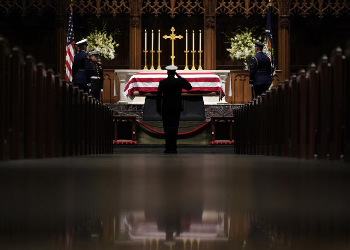 People pay their respects as the flag-draped casket of former President George H.W. Bush lies in repose at St. Martin's Episcopal Church Wednesday, Dec. 5, 2018, in Houston. (Photo: David J. Phillip, Pool/AP)