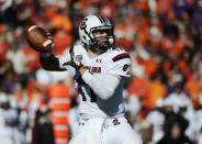South Carolina quarterback Dylan Thompson (17) looks to throw against Clemson during the first half of an NCAA college football game, Saturday, Nov. 29, 2014, in Clemson, S.C. (AP Photo/Rainier Ehrhardt)