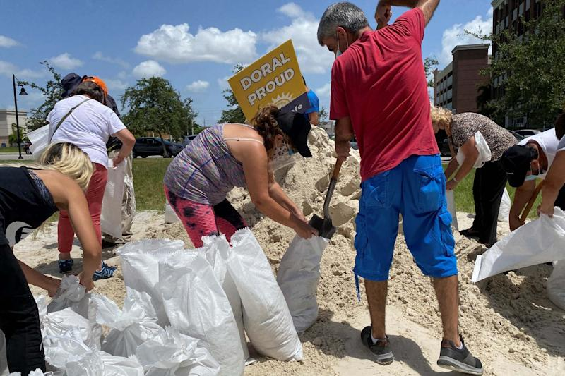 Residents fill and collect sand bags before the expected arrival of Hurricane Isaias in Doral, Florida (REUTERS)