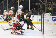 Vegas Golden Knights center Paul Stastny (26) scores on Calgary Flames goaltender David Rittich (33) during the second period of an NHL hockey game Saturday, Oct. 12, 2019, in Las Vegas. (AP Photo/Benjamin Hager)