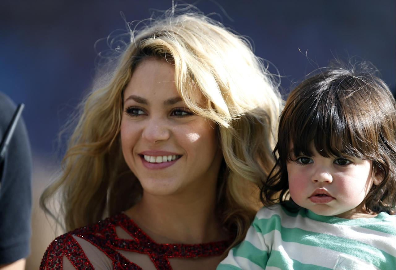Singer Shakira carries her son Milan after she performed during the closing ceremony prior to the World Cup final soccer match between Germany and Argentina at the Maracana Stadium in Rio de Janeiro, Brazil, Sunday, July 13, 2014. (AP Photo/Frank Augstein)