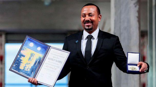 PHOTO: Ethiopian Prime Minister Abiy Ahmed Ali poses with medal and diploma after receiving Nobel Peace Prize during ceremony in Oslo City Hall, Norway, Dec. 10, 2019. (NTB Scanpix via Reuters, File)