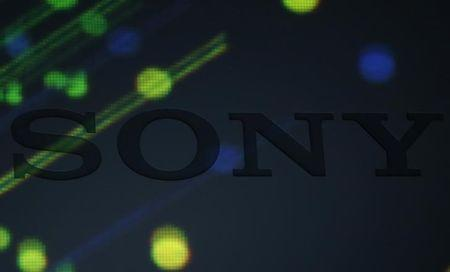 Various lights are cast on a logo of Sony Corp on a podium during its high resolution audio products unveiling event in Tokyo September 25, 2014. REUTERS/Yuya Shino