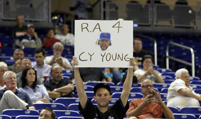 A fan holds a sign during a of a baseball game between the New York Mets and the Miami Marlins in Miami, Tuesday, Oct. 2, 2012. The Marlins won 4-3. (AP Photo/Alan Diaz)