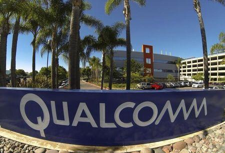 A Qualcomm sign is pictured in front of one of its many buildings in San Diego, California November 5, 2014. REUTERS/Mike Blake/Files