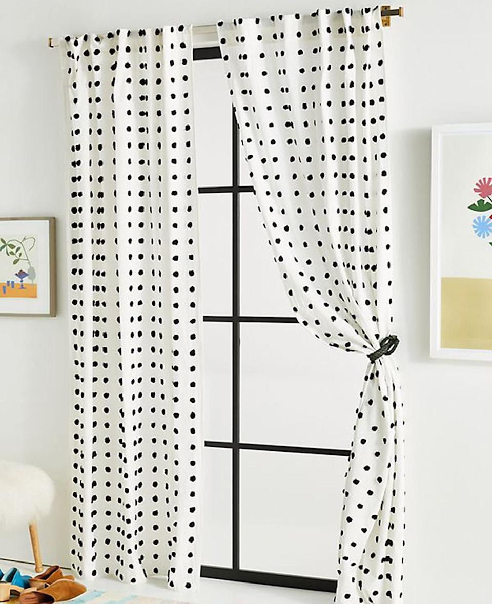 We can guarantee your bedroom will be more of a sanctuary if you finally hang some curtains. We love this pom-pom pair.