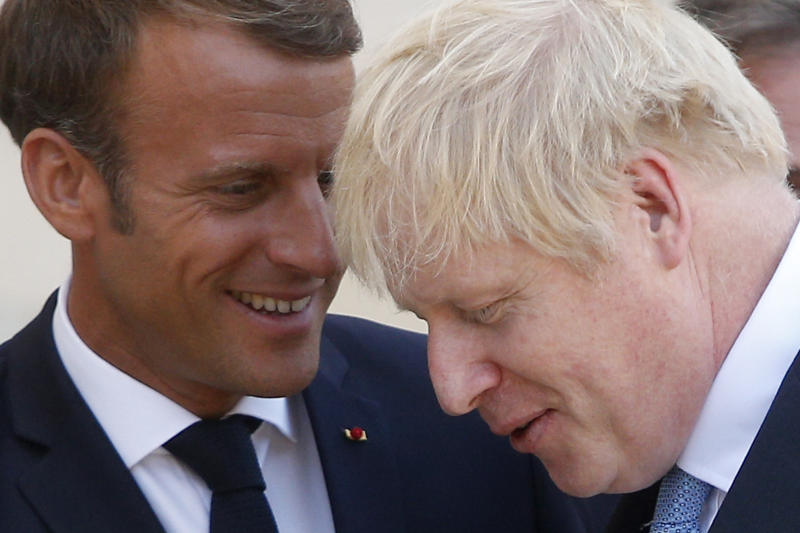 French President Emmanuel Macron, left, smiles to Britain's Prime Minister Boris Johnson after their talks at the Elysee Palace, Thursday, Aug. 22, 2019 in Paris. Boris Johnson traveled to Berlin Wednesday to meet with Chancellor Angela Merkel before heading to Paris to meet with French President Emmanuel Macron. (AP Photo/Michel Spingler)