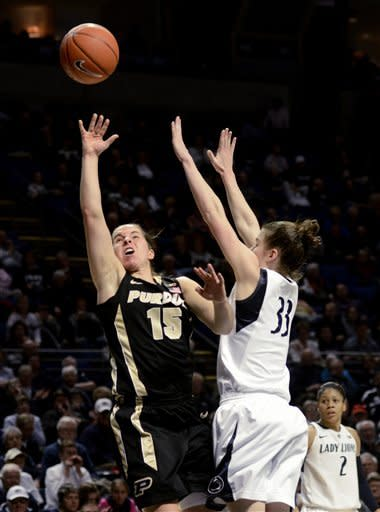 Purdue's Courtney Moses (15) shoots past Penn State's Maggie Lucas (33) during the second half of an NCAA college basketball game in State College, Pa., Monday, Feb. 4, 2013. Penn State won 69-61. (AP Photo/Ralph Wilson)