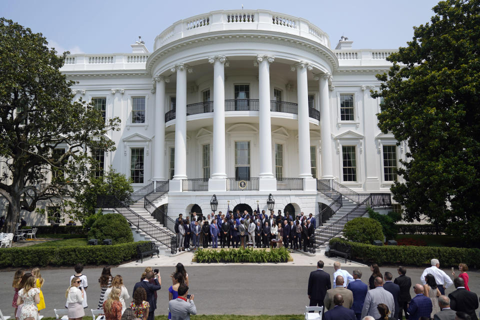 The Tampa Bay Buccaneers arrive for a ceremony on the South Lawn of the White House, in Washington, Tuesday, July 20, 2021, where President Joe Biden will honor the Super Bowl Champion Tampa Bay Buccaneers for their Super Bowl LV victory. (AP Photo/Andrew Harnik)