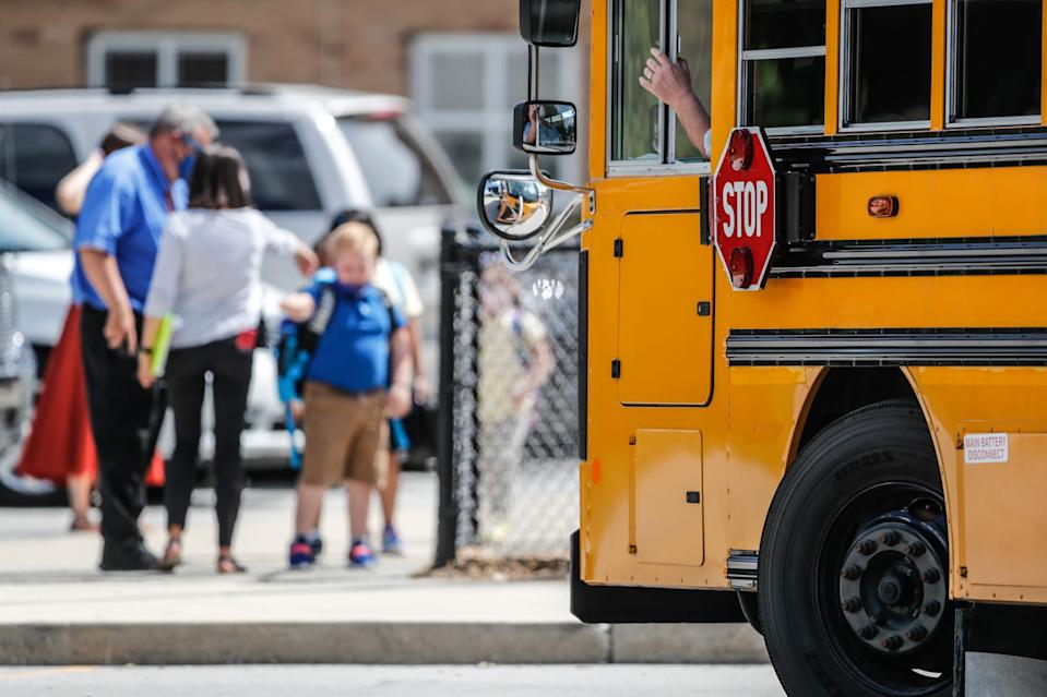 A bus waits to take students home from Homecroft Elementary School in Indianapolis on the first day of classes Wednesday.