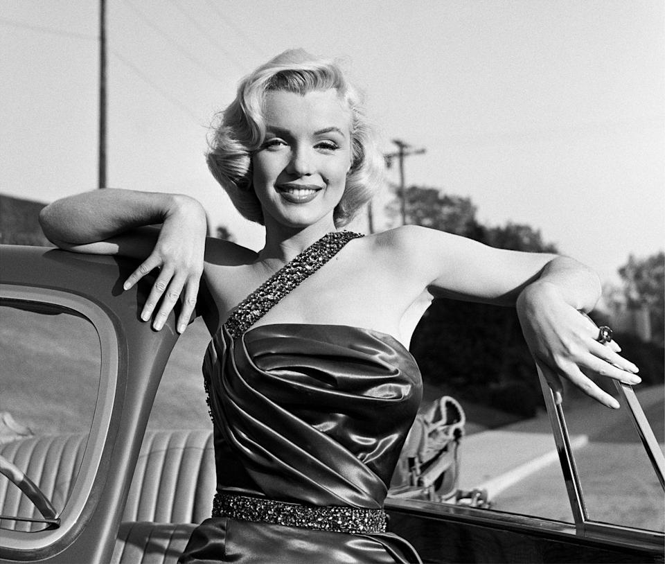 <p>When Marilyn Monroe busted onto the scene in the early '50s, her signature bob with smooth curls became the epitome of glamour and style. </p>