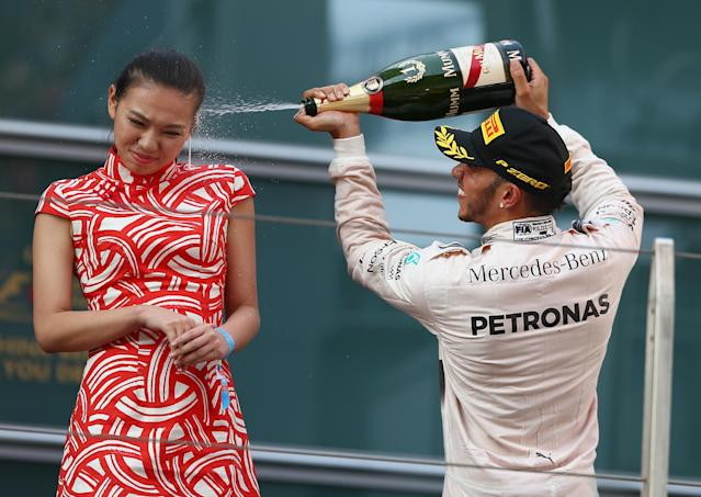 In 2015, Formula 1 driver Lewis Hamilton sprayed a grid girl model in the face with champagne after winning the Chinese Grand Prix. (Photo: Getty Images)