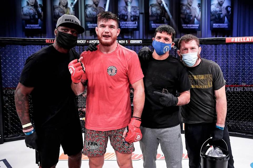 American Top Team's Johnny Eblen (second from left) with his coaches including King Mo (left) and Mike Brown (right).
