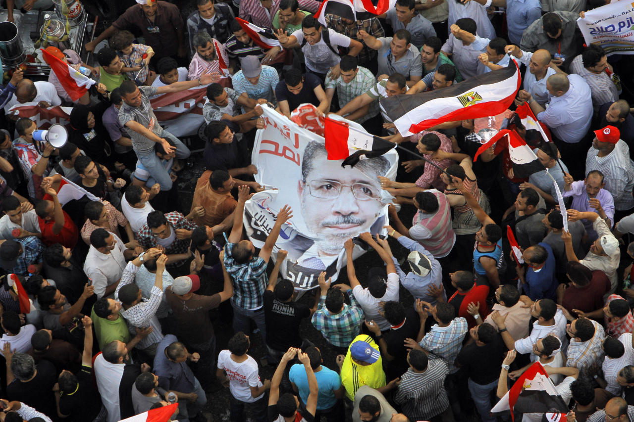 Egyptians celebrate the victory of Mohammed Morsi in the country's presidential election, at Tahrir Square in Cairo, Egypt, Sunday, June 24, 2012. Mohammed Morsi was declared Egypt's first Islamist president on Sunday after the freest elections in the country's history, narrowly defeating Hosni Mubarak's last Prime Minister Ahmed Shafiq in a race that raised political tensions in Egypt to a fever pitch. (AP Photo/Amr Nabil)