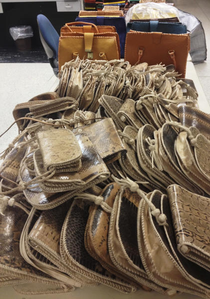 This photo released Monday, May 20, 2013, by U.S. Customs & Border Protection, shows some of hundreds of handbags made from the skin of snakes, lizards and crocodiles, among several contraband items seized by the agency at Los Angeles International Airport between May 6 and 10. Officials also seized elephant meat and a dead primate. The 387 purses were in the baggage of a passenger from Nigeria. They were made from skins of African rock pythons, monitor lizards, dwarf crocodiles, cobras and puff adder snakes. (AP Photo/U.S. Customs & Border Protection)