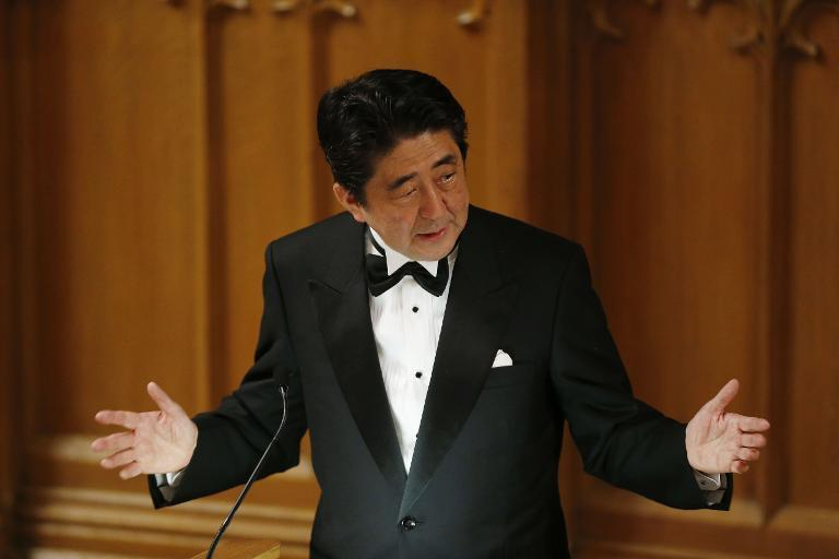 """Japanese Prime Minister Shinzo Abe speaking about his """"Abenomics"""" action plan for the economy in London on May 1, 2014"""