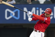 Texas Rangers' Nate Lowe loses control of his bat during the first inning of a baseball game against the Minnesota Twins in Arlington, Texas, Friday, June 18, 2021. (AP Photo/Andy Jacobsohn)