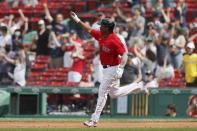 Boston Red Sox's Rafael Devers rounds the bases on his three-run home run during the fifth inning of a baseball game against the Los Angeles Angels, Sunday, May 16, 2021, in Boston. (AP Photo/Michael Dwyer)