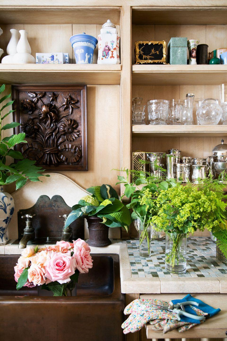 """<p>While Moss is fortunate enough to have a dreamy flower room, you can achieve a makeshift version by curating a """"floral toolbox"""" to bring into any space when crafting an arrangement. Her necessities include: florist tape (especially if you use glass vases often where a flower frog would be visible), flower shears and secateurs that fit your hands comfortably, chicken wire for positioning flowers, and twine or raffia to keep flowers in place. She also likes stem strippers to remove unwanted leaves and thorns, as well as bottle brushes to clean the nooks and crannies of your various containers.</p><p>Moss also suggests keeping two types of gloves around for arranging. She loves Foxgloves gardening gloves for working with non-thorny blooms and thicker Pine Tree gioves for favorites like roses, that have pesky thorns. </p>"""
