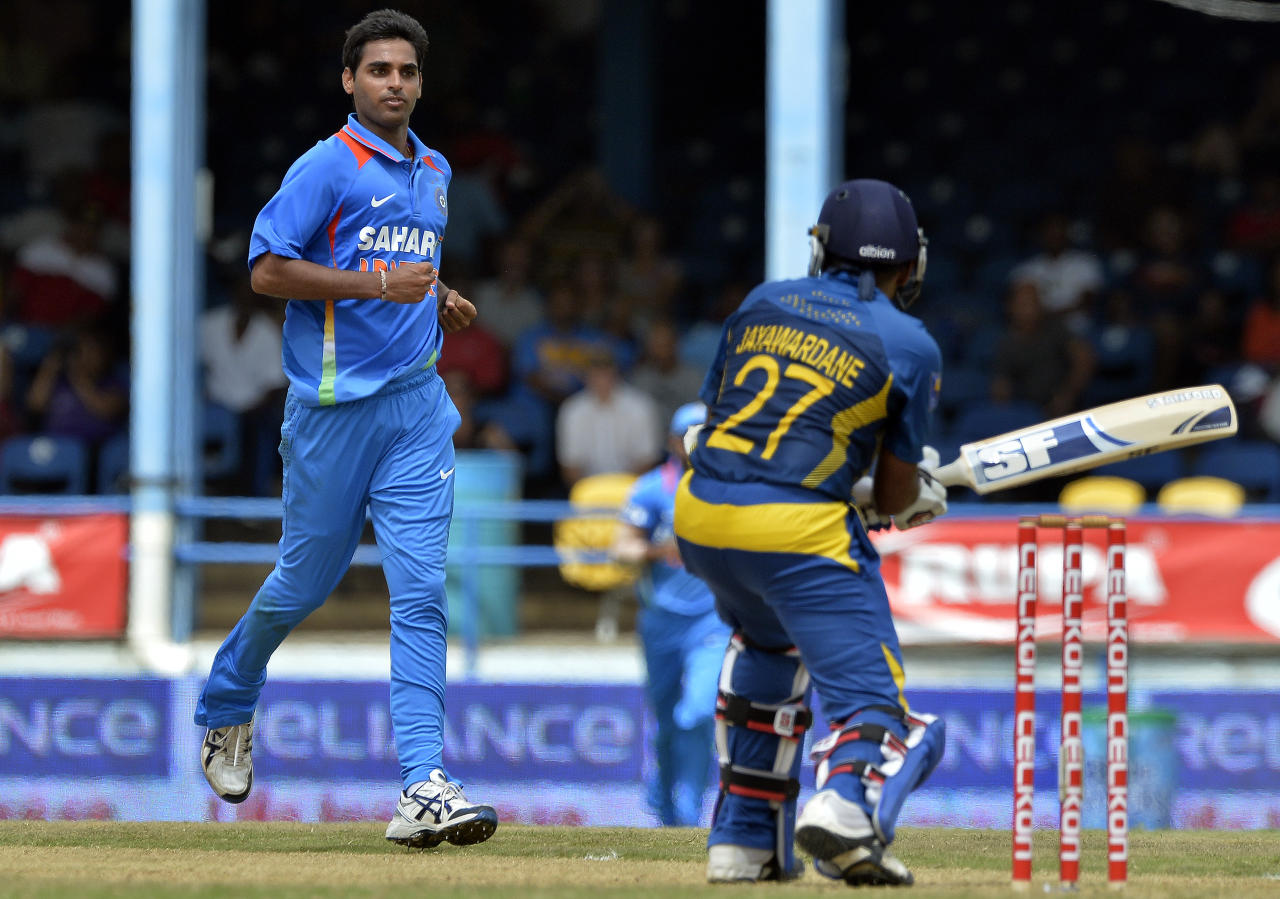 Indian cricketer Bhuvneshwar Kumar (L) celebrates dismissing Sri Lankan batsman Mahela Jayawardene (R) during the final match of the Tri-Nation series between India and Sri Lanka at the Queen's Park Oval stadium in Port of Spain on July 11, 2013. India won the toss and elected to field first. AFP PHOTO/Jewel Samad        (Photo credit should read JEWEL SAMAD/AFP/Getty Images)