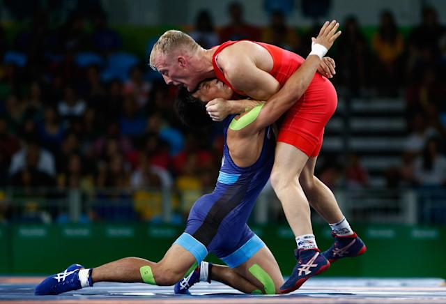 <p>Shinobu Ota of Japan (blue) competes against Stig-Andre Berge of Norway during the Men's 59 kg Greco-Roman Wrestling quarterfinals on Day 9 of the Rio 2016 Olympic Games at the Carioca Arena 2 on August 15, 2016 in Rio de Janeiro, Brazil. (Photo by Phil Walter/Getty Images) </p>