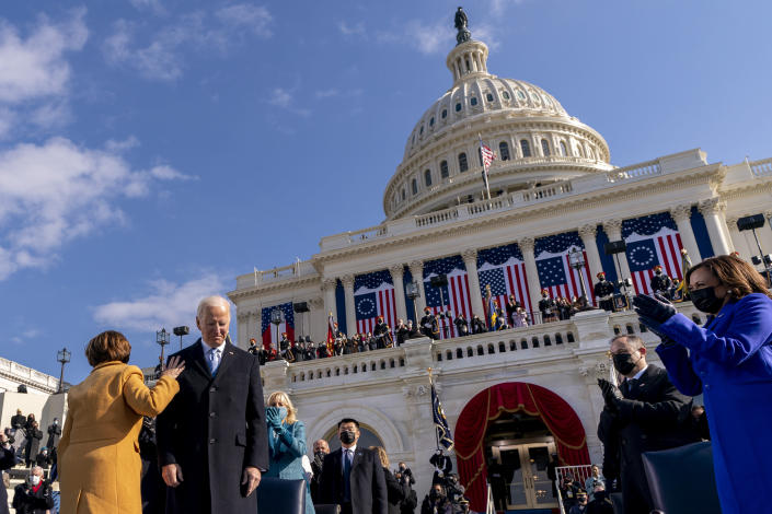 Sen. Amy Klobuchar, D-Minn., left, touches the shoulder of President Joe Biden after he is sworn in as the 46th president of the United States by Chief Justice John Roberts during the 59th Presidential Inauguration at the U.S. Capitol in Washington, Wednesday, Jan. 20, 2021, Also pictured is first lady Jill Biden, Vice President Kamala Harris, right, and her husband Doug Emhoff, second from right. (AP Photo/Andrew Harnik, Pool)