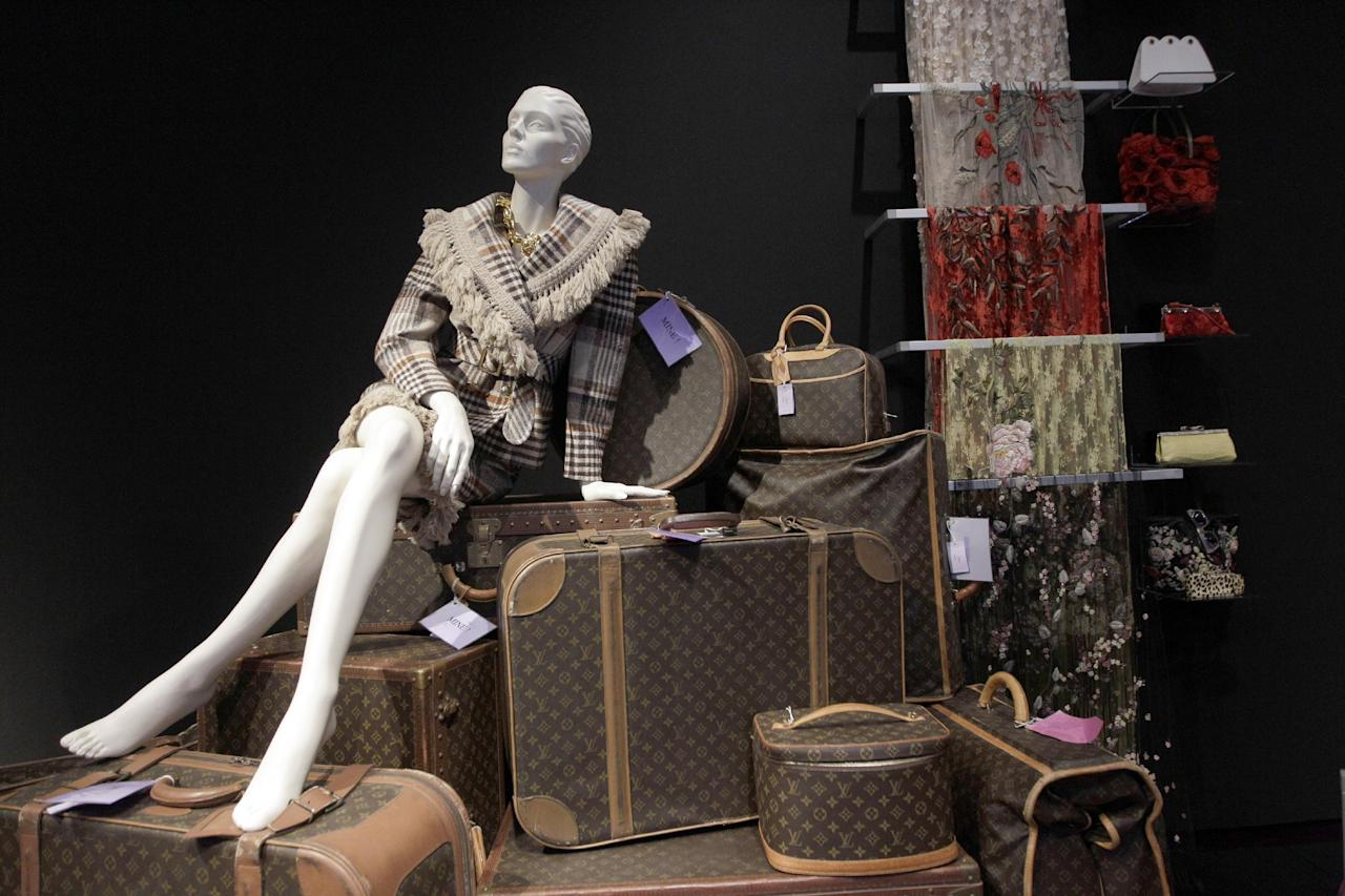 Clothing, luggage, scarfs and handbags are on display during a preview of the full Collection of Elizabeth Taylor at Christie's, Thursday, Dec. 1, 2011 in New York. The collection will be up for auction in person and online, a first for Christie's, from Dec. 13-17. (AP Photo/Mary Altaffer)