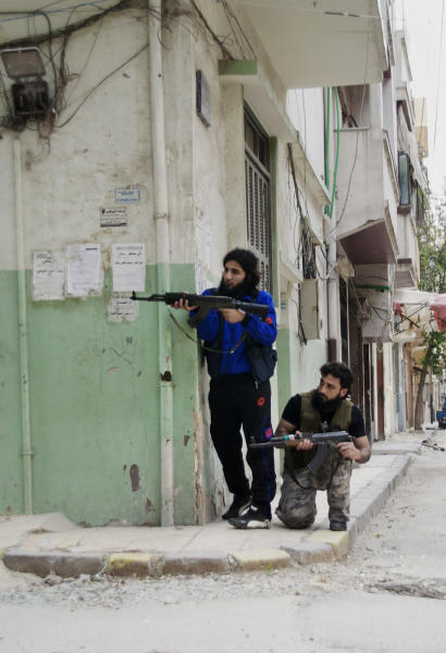 In this Monday, May 14, 2012 photo, Syrian rebels aim their machine guns at Khaldiyeh neighborhood in Homs province, central Syria. The violence around the country is eroding an internationally brokered peace plan that many U.N. observers see as the last hope to calm the 14-month-old crisis. (AP Photo/Fadi Zaidan)