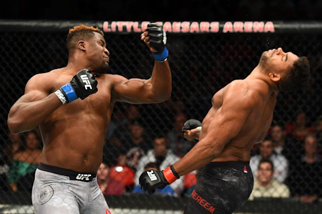 Francis Ngannou, left, flattens Alistair Overeem in December. (Getty)