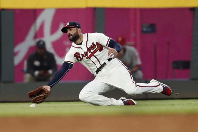 A ball hit for a double by Philadelphia Phillies pinch-hitter Adam Haseley drops in front of Atlanta Braves left fielder Nick Markakis during the sixth inning of a baseball game Tuesday, Sept. 17, 2019, in Atlanta. (AP Photo/John Bazemore)