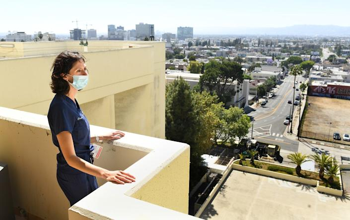 """Dr. Jamie Taylor stands in the resting area for doctors who treated COVID patients at Los Angeles Surge Hospital. <span class=""""copyright"""">(Wally Skalij/Los Angeles Times)</span>"""