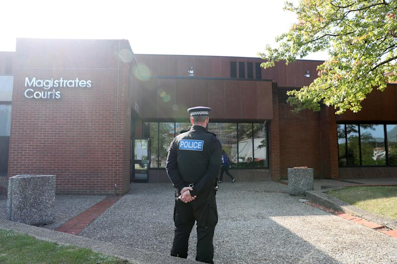 A police officer outside Reading Magistrates Court where Jed Foster appeared on Tuesday. (PA)