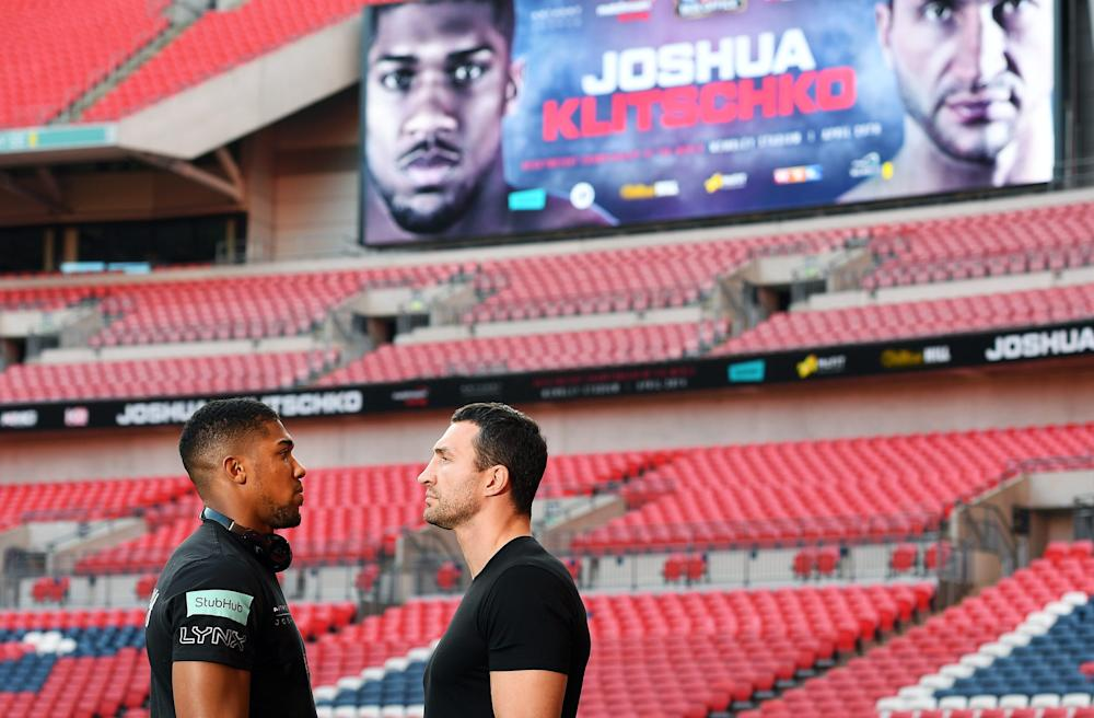 epa05675477 Britain's IBF heavyweight world champion Anthony Joshua (L) and Ukrainian boxer Wladimir Klitschko (R) face off following a press conference at Wembley Stadium in London, Britain, 14 December 2016. Joshua will fight Klitschko in a title bout at Wembley Stadium on 29 April 2017. EPA/ANDY RAIN Image Title: Anthony Joshua vs Wladimir Klitschko press conference at Wembley Stadium  - Credit: ANDY RAIN/EPA