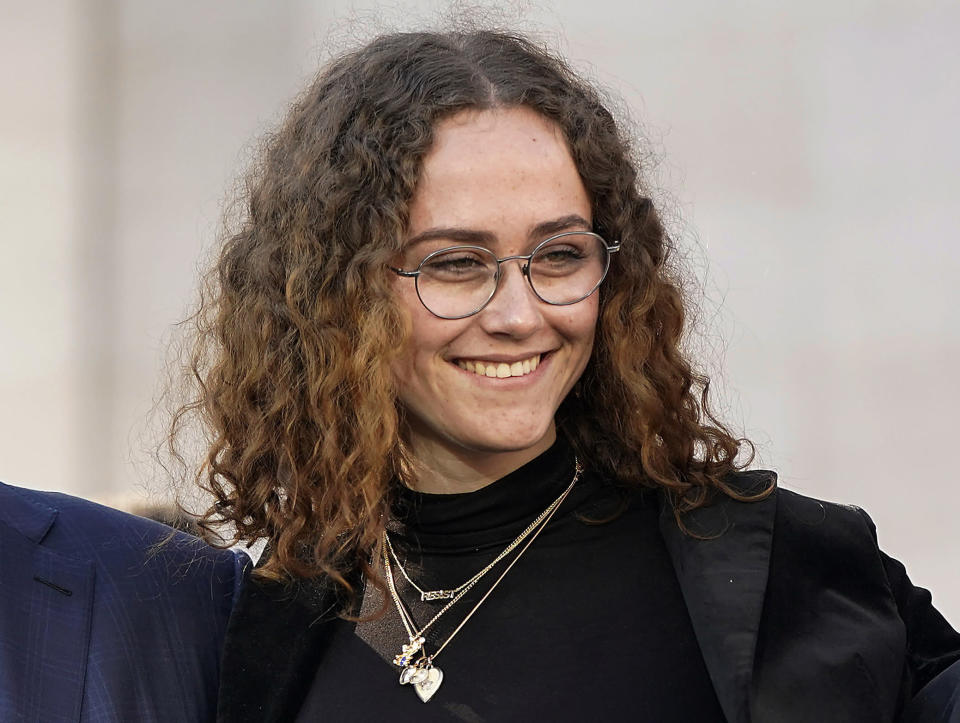 FILE -Ella Emhoff appears at a rally for her stepmother Sen. Kamala Harris, announcing Harris' presidential campaign in Oakland, Calif., Sunday, Jan. 27, 2019. The designers at Proenza Schouler dressed Ella Emhoff in a couple of coats (plus a pantsuit) for her modeling debut in their new collection, unveiled Thursday for New York Fashion Week. Designers Lazaro Hernandez and Jack McCollough said the fashion world took quick notice when 21-year-old Emhoff appeared at the inauguration in January, dressed in a quirky Miu Miu coat with bejeweled shoulders along with a starchy white collar. (AP Photo/Tony Avelar, File)