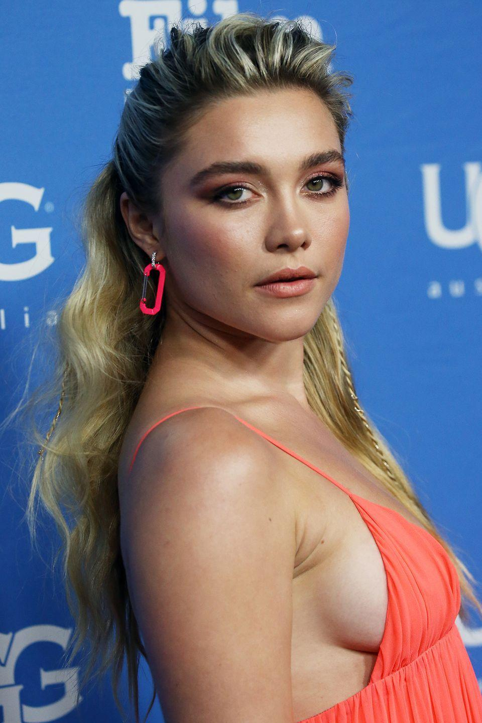 <p>Florence Pugh's voluminous waves are pulled and tied to the back, with some key volume at the crown. She adds a small braid cascading down for some added bohemian style. </p>