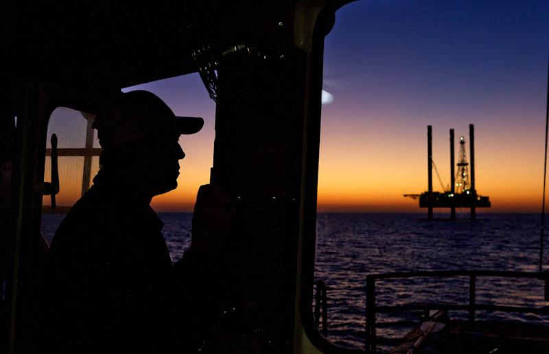 Silhouette of an offshore oil and gas jack up drilling at sunset. (Photo by: Education Images/Universal Images Group via Getty Images)