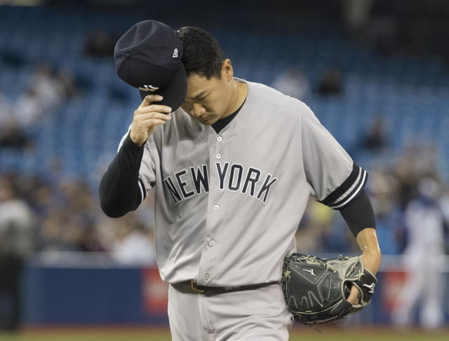 New York Yankees starting pitcher Masahiro Tanaka comes off the field at the end of the fifth inning of a baseball game against The Toronto Blue Jays in Toronto, Friday, Sept. 13, 2019. (Fred Thornhill/The Canadian Press via AP)