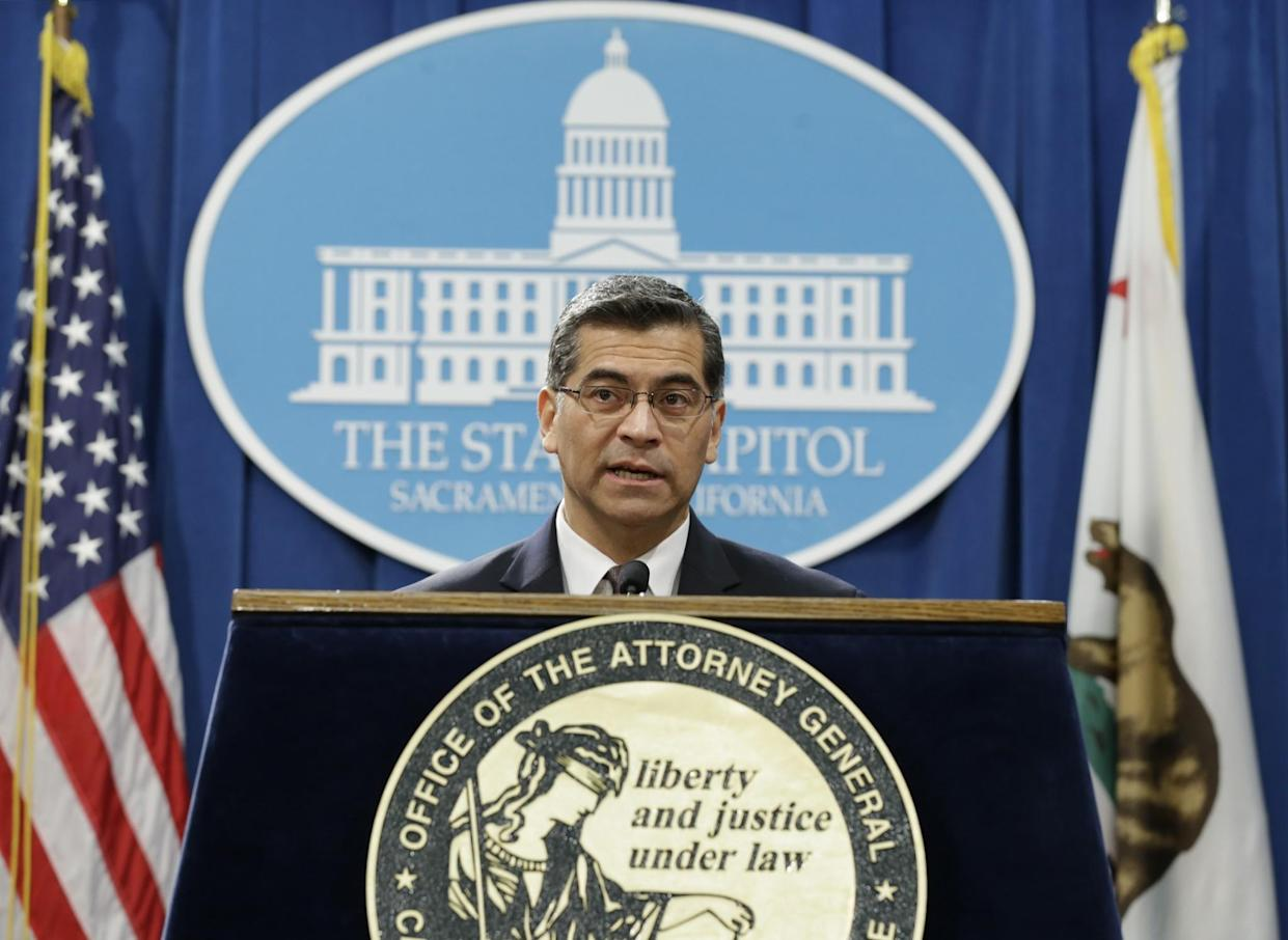 Xavier Becerra, California's new attorney general, talks to reporters in Sacramento in January. (Photo: Rich Pedroncelli/AP)