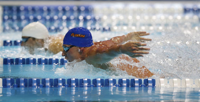Ryan Lochte, right, and Michael Phelps compete in the men's 400-meter individual medley final at the U.S. Olympic swimming trials, Monday, June 25, 2012, in Omaha, Neb. (AP Photo/David Phillip)