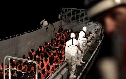 Migrants are rescued by staff members of the MV Aquarius, a search and rescue ship in the central Mediterranean Sea - Credit: Karpov/Reuters