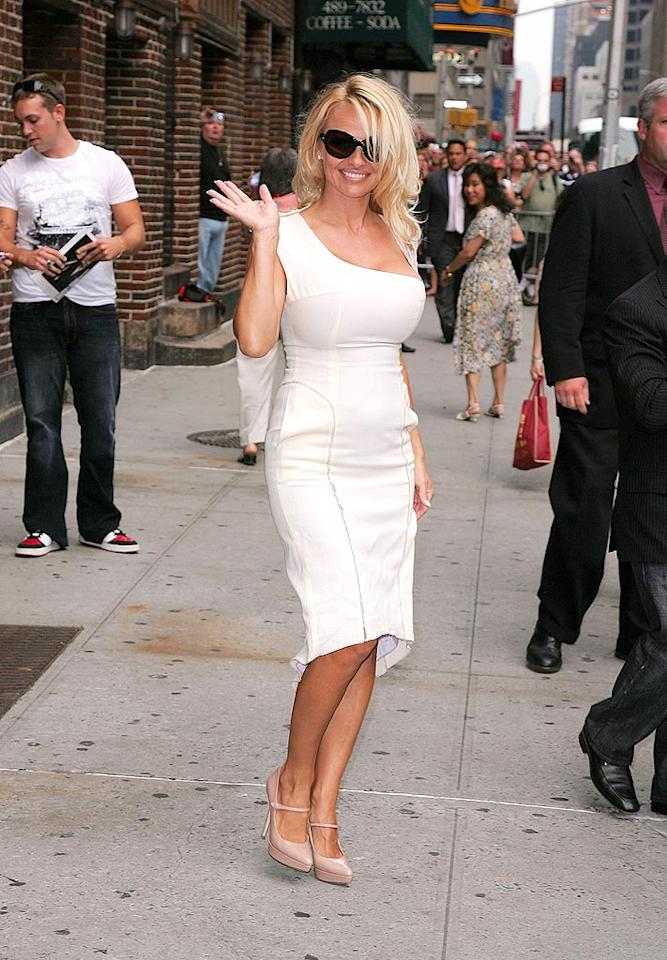 "Pam Anderson tends to opt for white ensembles and we can see why; they always show off her sunny SoCal glow wherever she goes. James Devaney/<a href=""http://www.wireimage.com"" target=""new"">WireImage.com</a> - July 30, 2008"