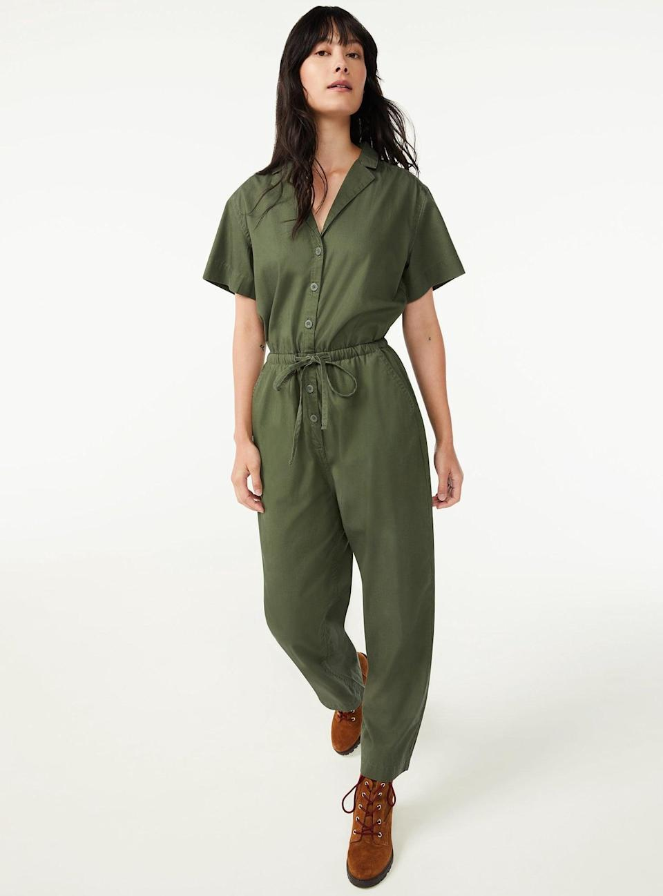 <p>Wear this <span>Free Assembly Women's Short Sleeve Jumpsuit</span> ($36) on its own before the cold weather sets in, and then layer it under your coziest jacket when it (tragically) does. We love how it has an elasticized drawstring waistband so you can customize it to fit you perfectly.</p>