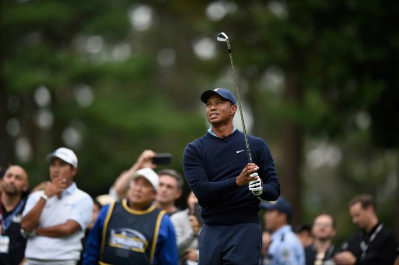 Golf: First hole at Torrey Pines bites Woods again