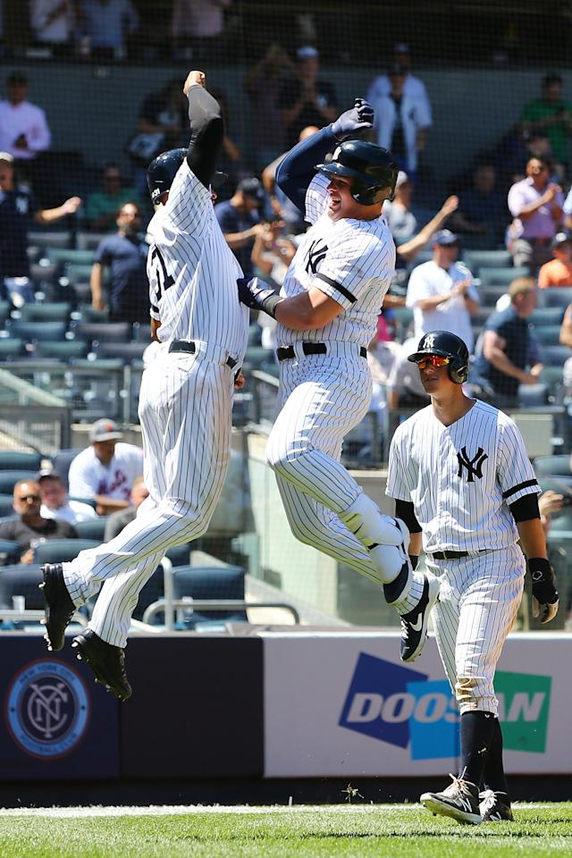 NEW YORK, NEW YORK - JUNE 11: Luke Voit #45 of the New York Yankees celebrates after hitting a three run home run to left field in the fourth inning against the New York Mets at Yankee Stadium on June 11, 2019 in New York City. (Photo by Mike Stobe/Getty Images)